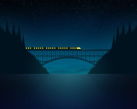Train on a bridge at night